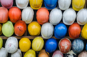 Colorful hard hats in a row
